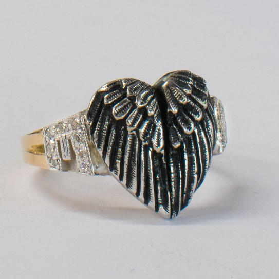This ring was custom made to commemorate a loved one who has gone to heaven, complete with their initials.