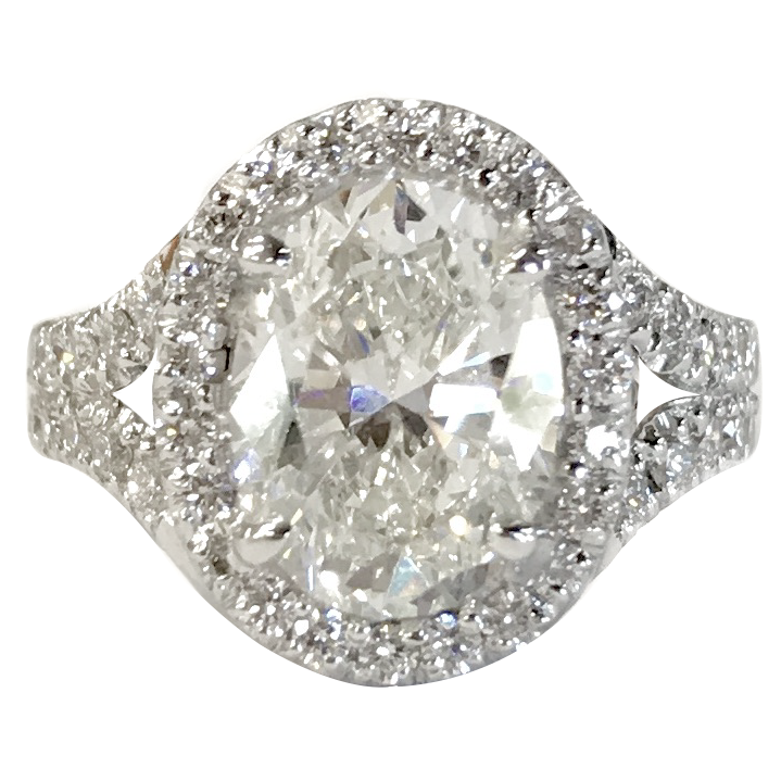 Custom designed oval engagement ring with a halo and split shank.